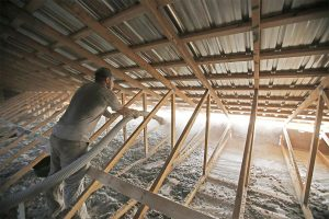 Cellulose insulation being applied